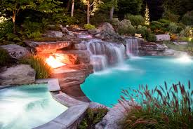 japanese natural swimming pool design with a stone fire pit and
