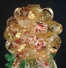gold poinsettia tree topper bow tree