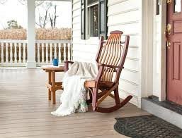 black rocking chair on front porch with lantern outdoor wicker