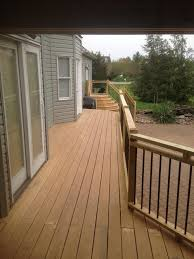 pressure treated wood deck build and partial enclosed roof in