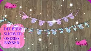 diy baby shower decor onesies banner floral garden theme