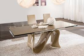unique rectangular modern dining table with artwork base on white