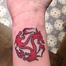 dragon tattoo wrist tattoo pictures to pin on pinterest tattooskid