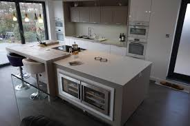 kitchen island worktops mix of corian and spekva wood designed by by design and
