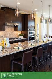 71 best kitchens images on pinterest winchester kitchen ideas the finley model s eat in kitchen features dark cabinets with light granite countertops that provide the perfect contrast to the natural stone backsplash