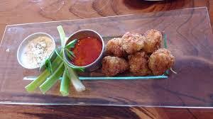 cuisine alligator alligator so um the buffalo sauce and celery were