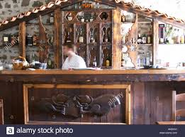 the upstairs bar with traditional country style wooden carvings