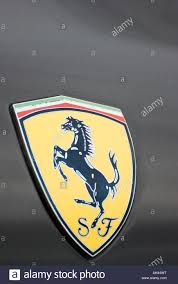 ferrari badge ferrari badge on black car wing stock photo royalty free image
