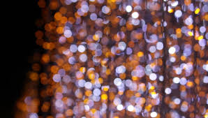 blurred lights balls of a garlands colorful lamps square of