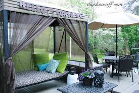 how to add curtains to an outdoor covered patio swing hometalk
