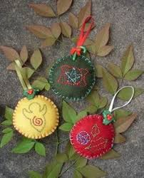 felt yule ornaments i like the one with the goddess symbol