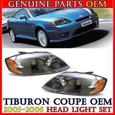 hyundai tiburon oem parts genuine hyundai black bezel headlight l set 921012c500