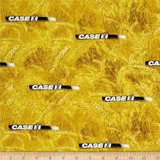 case ih logo allover yellow discount designer fabric fabric com