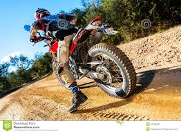 on road motocross bikes motocross bike taking off on dirt road stock photo image 47193239