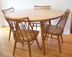 mid century modern dining table and chairs by russel wright for