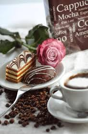 box cuisine patisserie cakes with coffee beans cup of coffee and box with letters