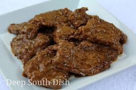 deep south dish steak and gravy with onion