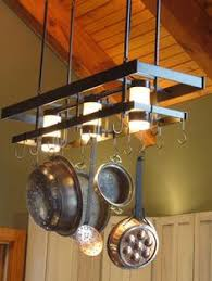 kitchen pot racks with lights hanging pot rack with lights pinteres