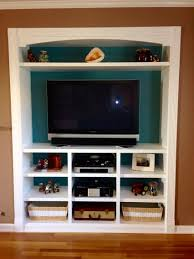 closet space turned into a built in entertainment center for