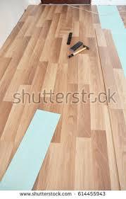 Wood Floor Installation Tools Contractor Installing Wooden Laminate Flooring Insulation Stock
