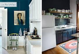 black walnut bookcase blue kitchen walls with white cabinets