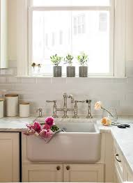 Farm Sink With Backsplash by Ivory Kitchen Cabinets With Beveled Subway Tile Backsplash