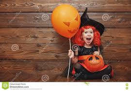 halloween background fun funny child in witch costume for halloween with pumpkin ja
