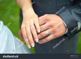 hand man rings images Loving couple holding hands rings stock photo edit now 77346130 jpg
