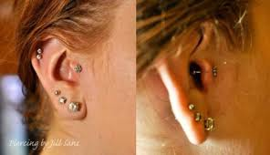 burly fish tattoo and piercing