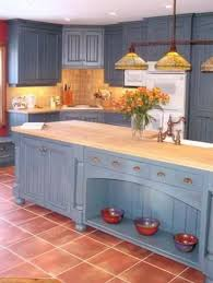 what color floor with blue cabinets blue cabinets with saltillo look tile floors and
