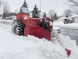 farmall sidewalk snowplow at work photo farmall