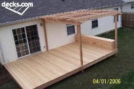 nice simple deck with half covered in pergola plus box seat
