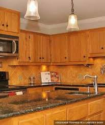 brown kitchen cabinets with backsplash painting kitchen cabinets before after