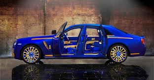 rolls royce dark blue mansory rolls royce ghost upgrades in white and electric blue gold