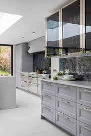 how to clean oak kitchen cabinets uk a hint of blue in grey cabinets paired with nickel and wood