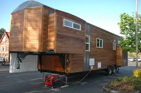 tiny house with slide outs built on a gooseneck trailer house