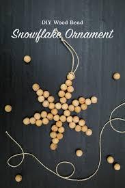 diy wood bead snowflake ornaments tinselandtrim
