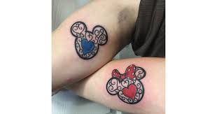colorful mickey and minnie mouse faces disney couple tattoos