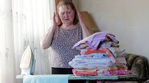 elderly woman clothes tired elderly woman ironing clothes stock footage videoblocks