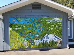 dr sonya hamberg celebrates a marriage mural and a year at the mural created by sarah forbes has many famous and funny landmarks on it including the lacey family dental s tooth which jared decorates at christmas