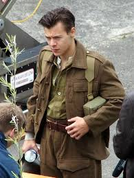 harry styles shows off his new short haircut on set of world war