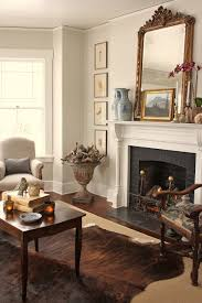 Cowhide Rug In Living Room Cowhides Layered Over Natural Fiber Rugs Driven By Decor