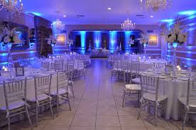 silver chiavari chairs wedding reception silver chiavari chairs and blue uplighting