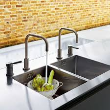 Double Sinks Double Sink And Faucets Built In A Quarella Composite And Welded