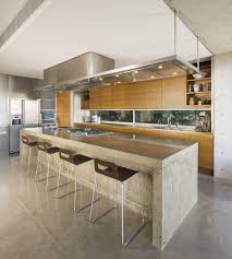 stylish kitchen with breakfast bar also modern kitchen sink on