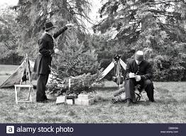 a civil war soldier reenactor at time decorating a