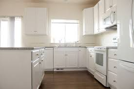 why is everyone painting their kitchen cabinets white kitchen renovation series painting our kitchen cabinets