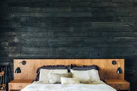 master suite with charred accent wall wood patterned bathroom