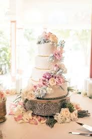 classic wedding cakes chic wedding with a lush floral wall backdrop classic wedding