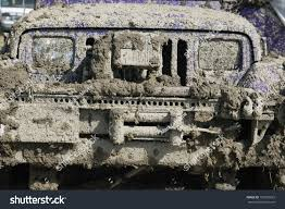 muddy jeep close view very muddy jeep grill stock photo 123993625 shutterstock